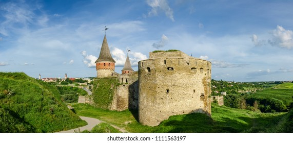 Kamianets-Podilskyi fortress built in the 15th century. View of western towers and walls of the castle on background of the city and sky, Khmelnytskyi oblast, Ukraine