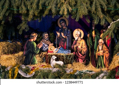 KAMIANSKE, UKRAINE - JAN 21, 2018: Christmas manger scene beside St. Nicholas Church in Kamianske. Nativity scene with shepherds and characters of the birth of Jesus Christ.