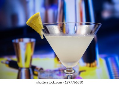 Kamikaze cocktail in martini glass decoreted slice of lemon