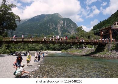 KAMIKOCHI, JAPAN - AUGUST 07, 2018: Image of Kappa bridge,  This bridge is a very beautiful wooden suspension bridge at Kamikochi, Japan.