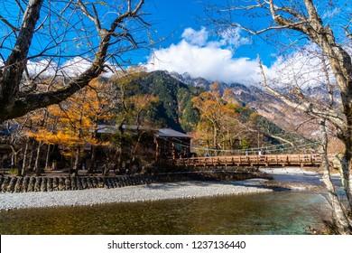 KAMIKOCHI, JAPAN - OCTOBER 31, 2018: Image of Kappa bridge, This bridge is a very beautiful wooden suspension bridge at Kamikochi, Japan.