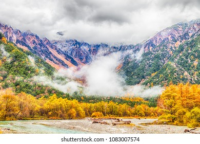 Kamikochi National Park in the Northern Japan Alps of Nagano Prefecture, Japan. Beautiful mountain in autumn leaf with river.