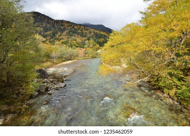 Kamikochi 's forested national park in the Japanese Alps featuring hiking trails, lodging & picturesque views in autumm season, Nagano, Japan