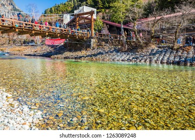 KAMIKOCHI,NAGANO,JAPAN-NOVEMBER 15,2018: Many tourists on the kappa wooden bridge at Kamikochi, the northern part of the Japan Alps. Beautiful scenery.There are many natural and adventure hiking trail