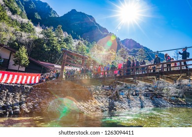 KAMIKOCHI,NAGANO,JAPAN-NOVEMBER 15,2018: Many tourists on the kappa wooden bridge at Kamikochi, the northern part of the Japan Alps. Beautiful scenery There are many natural and adventure hiking trail