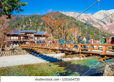 KAMIKOCHI,NAGANO,JAPAN-NOVEMBER 15,2018: Many tourists on the kappa wooden bridge at Kamikochi, the northern part of the Japan Alps. Beautiful scenery .There are many natural trails