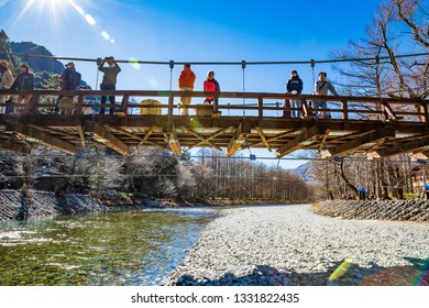 KAMIKOCHI,NAGANO,JAPAN-NOVEMBER 15,2018: Many tourists on the kappa wooden bridge at Kamikochi, the northern part of the Japan Alps .There are many natural and adventure hiking trails