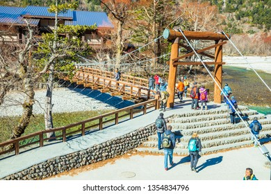 KAMIKOCHI,NAGANO,JAPAN-NOVEMBER 15,2018: Many tourists on the kappa wooden bridge at Kamikochi,northern part of the Japan Alps. Beautiful scenery .There are many natural and adventure hiking trails