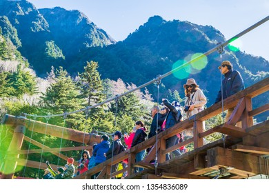 KAMIKOCHI,NAGANO,JAPAN-NOVEMBER 15,2018: Many tourists on the kappa wooden bridge at Kamikochi, northern part of the Japan Alps. Beautiful scenery .There are many natural and adventure hiking trail