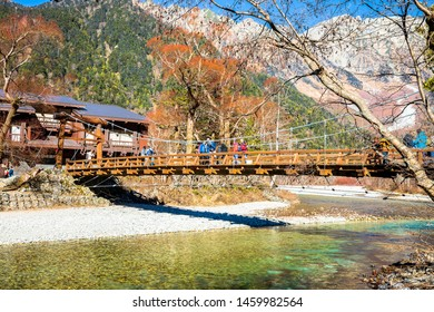 KAMIKOCHI,NAGANO,JAPAN-NOVEMBER 15,2018: Many tourists on the kappa wooden bridge at Kamikochi, the northern part of the Japan Alps. Beautiful scenery .There are many natural