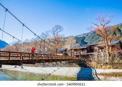 KAMIKOCHI,NAGANO,JAPAN-NOVEMBER 15,2018: Tourist  take photo on the kappa wooden bridge at Kamikochi, the northern part of the Japan Alps. Beautiful scenery .There are many natural and adventure