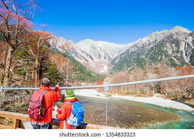 KAMIKOCHI,NAGANO,JAPAN-NOVEMBER 15,2018: Tourists on the kappa wooden bridge at Kamikochi, the northern part of the Japan Alps. Beautiful scenery .There are many natural and adventure hiking trails