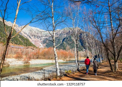 KAMIKOCHI,NAGANO,JAPAN-NOVEMBER 15,2018: Tourst walk alongside the Azusa River at Kamikochi, the northern part of the Japan Alps. Beautiful scenery .There are many natural and adventure hiking trails