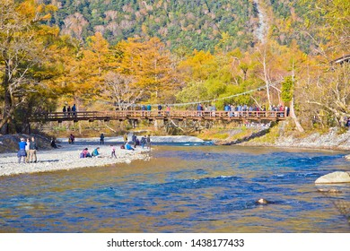 KAMIKOCHI,NAGANO,JAPAN-October 2018: Tourists on the kappa wooden bridge at Kamikochi National park, the northern part of the Japan Alps in Chubu region.