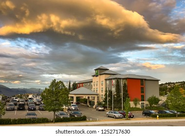 KAMLOOPS, BRITISH COLUMBIA, CANADA - JUNE 2018: Wide angle view of the Holiday Inn Express hotel in Kamloops, with colored clouds in the sky at dusk.