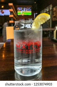 KAMLOOPS, BRITISH COLUMBIA, CANADA - JUNE 2018: Water with ice and lemon in a jam jar glass in the Match Eatery and Public House inside the Cascades Casino in Kamloops.