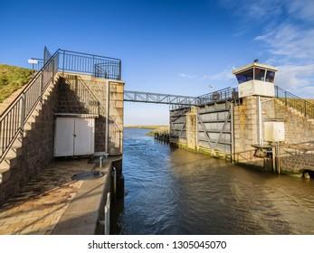 Kammerslusen open gates to the Wadden sea near Ribe, Denmark