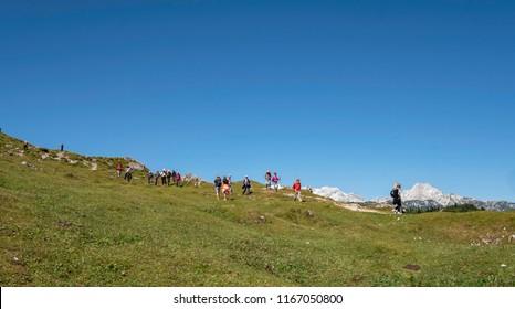 KAMNIK, SLOVENIA - AUGUST 27, 2018:  Hikers on Velika planina (Big Pasture Plateau)