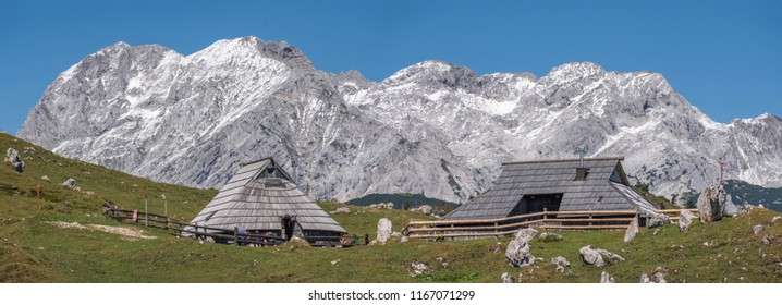 KAMNIK, SLOVENIA - AUGUST 27, 2018:  Panoramic view of traditional cottages on Velika planina (Big Pasture Plateau) in front of Kamnik-Savinja Alps