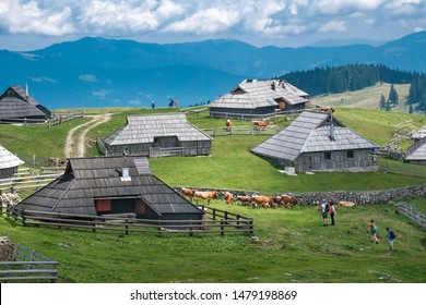 KAMNIK, SLOVENIA - AUGUST 5, 2019: Pastures with traditional wooden cottages in village on Velika planina (Big Pasture Plateau)