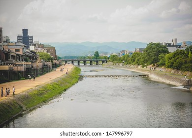 Kamo river in the center of Kyoto in summer. The relaxing of local people and visitors in Kyoto.