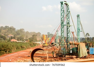 KAMPALA, UGANDA - 2017: Large scale road construction works perfomed by a Chinese contractor. The Chinese government is investing hugely in the East African infrastructure sector.