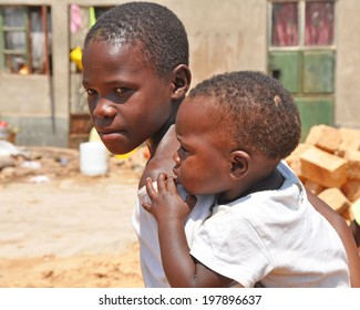 KAMPALA, UGANDA, AFRICA - CIRCA FEBRUARY 2009: Unidentified boys living in the Kampala slums circa February 2009 in Uganda, Africa. Kampala is the largest city and capital of Uganda.