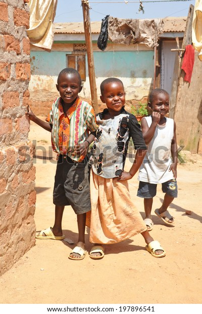 KAMPALA, UGANDA, AFRICA - CIRCA FEBRUARY 2009: Unidentified children living in the Kampala slums circa February 2009 in Uganda, Africa. Kampala is the largest city and capital of Uganda.