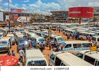 KAMPALA, UGANDA - APRIL 11, 2017: The big parking lot for mini bus taxis in the center of Kampala. Kampala is the capital city of Uganda in East Africa.
