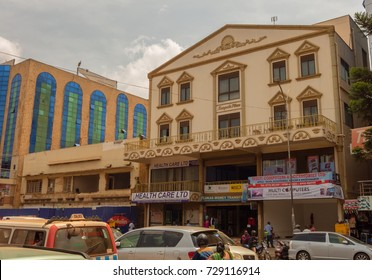 KAMPALA, UGANDA - APRIL 15, 2017: Kampala Road This road is full of shops and other business buildings like The Craft Centre and Health Care Ltd.. Kampala is the capital city of Uganda.