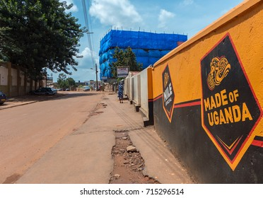 KAMPALA, UGANDA - APRIL 22, 2017: A road in the quieter part of Kampala The areas outside the center of Kampala are mostly older and not in a very good state.