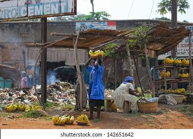 KAMPALA, UGANDA - AUG 26: Native people sell banana at local market on Aug 26, 2010 in slum of Kampala. Nearly 40% of slum dwellers have a monthly income of just 2,500 shillings �¢?? less than a dollar