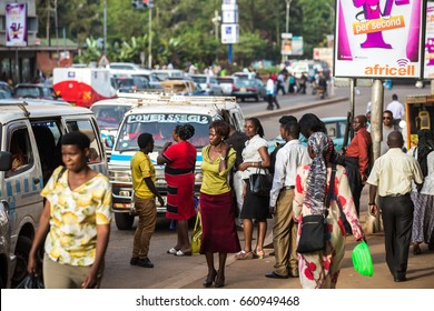KAMPALA, UGANDA - CIRCA NOV, 2016: People at the bus stop. Daily life in Kampala, Uganda.