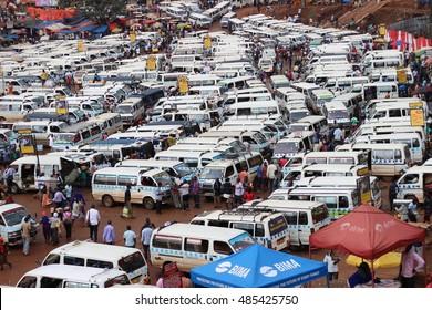 KAMPALA, UGANDA - CIRCA NOVEMBER 2015: A landscape photo of Kampala's main bus stop which reflects organised chaos.