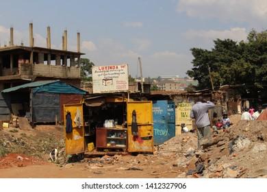 Kampala, Uganda - February 3, 2015: Street and shops in the slums of the capital of Uganda - Kampala.