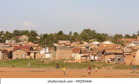 KAMPALA, UGANDA - JANUARY 10, 2008: Numerous schoolmates play on meadow on January 10, 2008 in Kampala.