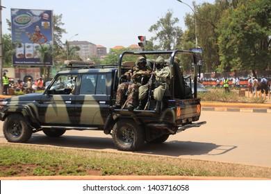 Kampala, Uganda - January 21, 2015: military vehicle with military with machine guns in the city center.