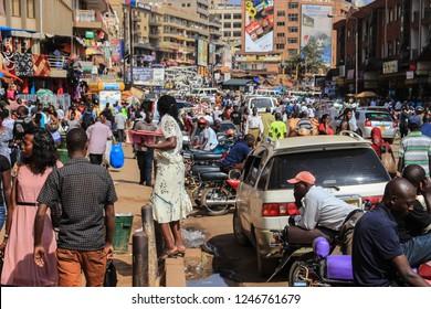 Kampala, Uganda - January 28, 2018: The street life of Uganda's capital. Crowd of people on the streets and heavy traffic