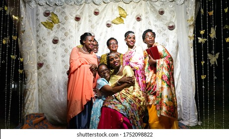Kampala, Uganda - July 09, 2017: a big African family takes portrait photography at the wedding, happiness and joy, three generations of grandmother, mother and daughter, beautiful happy Ugandan lady
