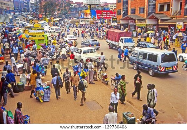 KAMPALA, UGANDA - JULY 24: An unidentified people on the street on July 24, 2004 in Kampala, Uganda. Uganda is one of the poorest nations in the world.