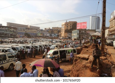 KAMPALA, UGANDA - JUNE 6, 2016: The big parking lot for mini bus taxis in the center of Kampala.  Dirty life in Kampala. Chaotic taxi park on a normal week day in Kampala