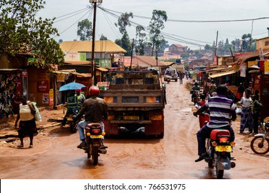 KAMPALA, UGANDA – OCTOBER 05, 2016: Very busy street in Kampala on a Saturday morning. Boda boda's, trucks and people show the life of Uganda.