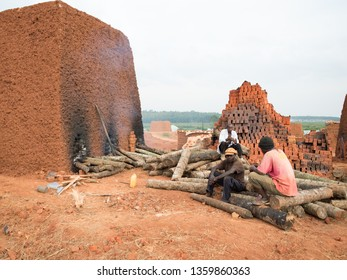 Kampala / Uganda - October 2, 2013: Men working in a brick factory in the outskirts of Kampala