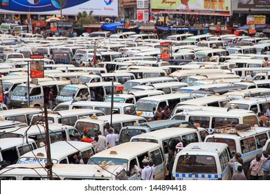 KAMPALA, UGANDA - SEPTEMBER 28, 2012 - Hundreds of public transport taxis, wait for passengers in the chaotic taxi park (public bus station) in Kampala, Uganda, on September 28, 2012.