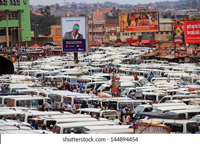 KAMPALA, UGANDA - SEPTEMBER 28, 2012.  The public transportation hub in downtown Kampala, Uganda.  Taxis (buses) wait for passengers in the large taxi park in Kampala, Uganda, on September 28, 2012.