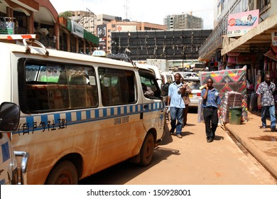 KAMPALA, UGANDA - SEPTEMBER 28, 2012.  Taxis line up on city streets while waiting to get into the main taxi station in Kampala, Uganda on September 28,2012.
