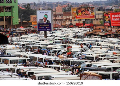 KAMPALA, UGANDA - SEPTEMBER 28, 2012.  The chaos of the busy and crowded taxi park in downtown Kampala, Uganda on September 28,2012.
