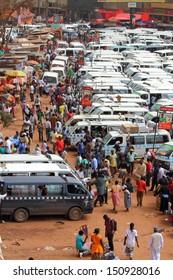 KAMPALA, UGANDA - SEPTEMBER 28, 2012.  Daily life unfolds in the main taxi park in Kampala, Uganda on September 28,2012.
