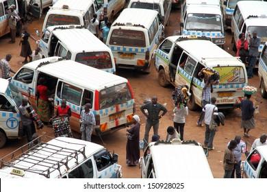 KAMPALA, UGANDA - SEPTEMBER 28, 2012.  Ugandans move about through the taxi park in downtown Kampala, Uganda on September 28,2012.
