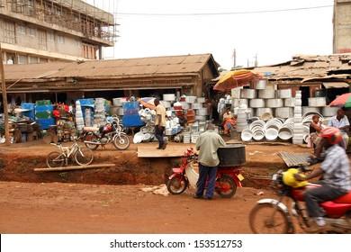 KAMPALA, UGANDA - SEPTEMBER 28, 2012.  Vendors sell a variety of pots, pans, and chests on the streets of Kampala, Uganda on September 28,2012.